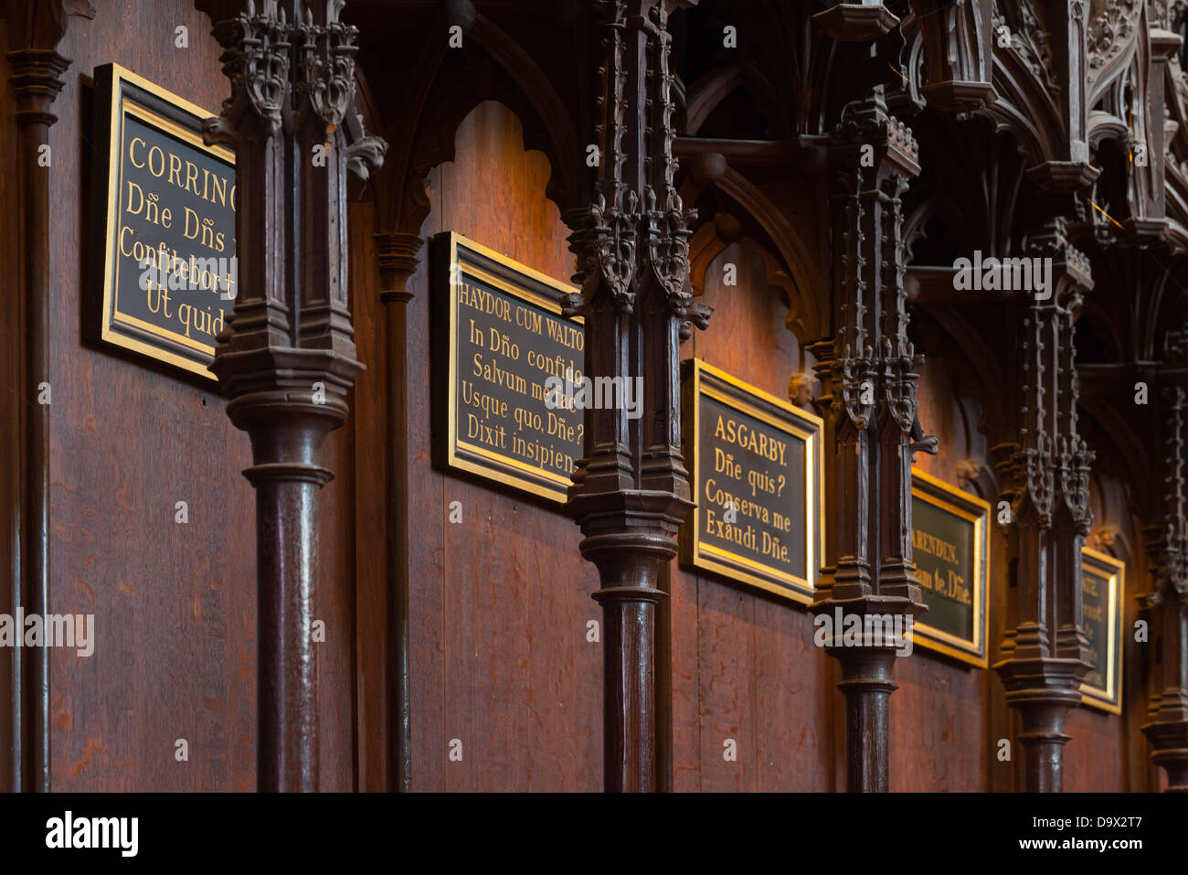 Lincoln - St. Hugh's choir seats with nameplates inside the Cathedral; Lincoln, Lincolnshire, UK, Europe - Stock Image