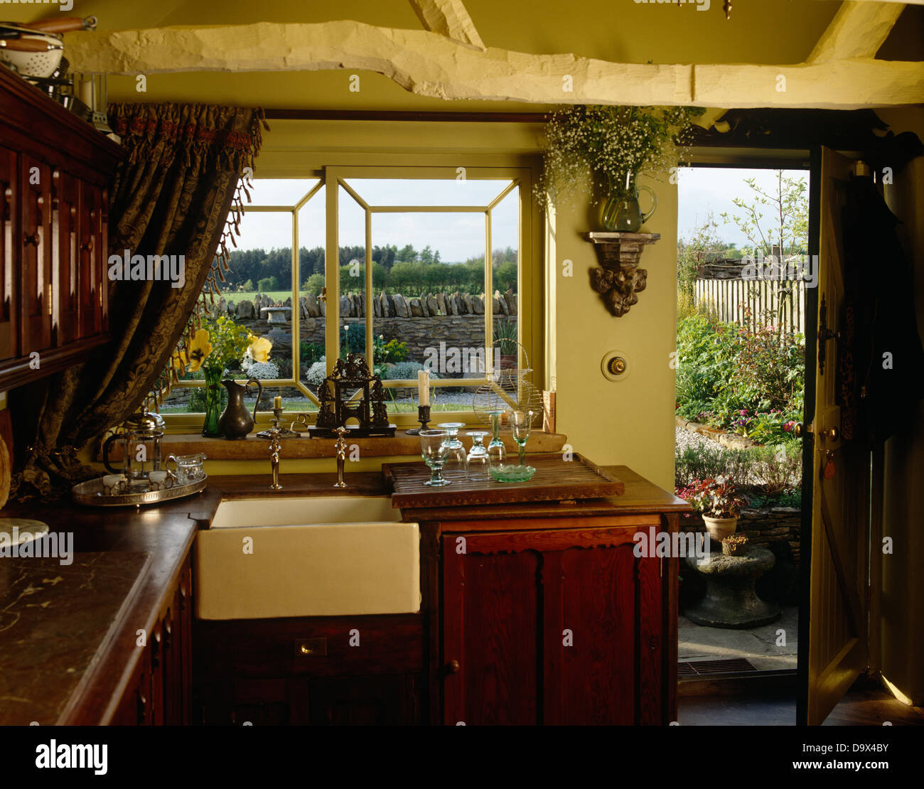 Old Country Kitchen: Old Fashioned Belfast Sink Beneath Window In Country Style