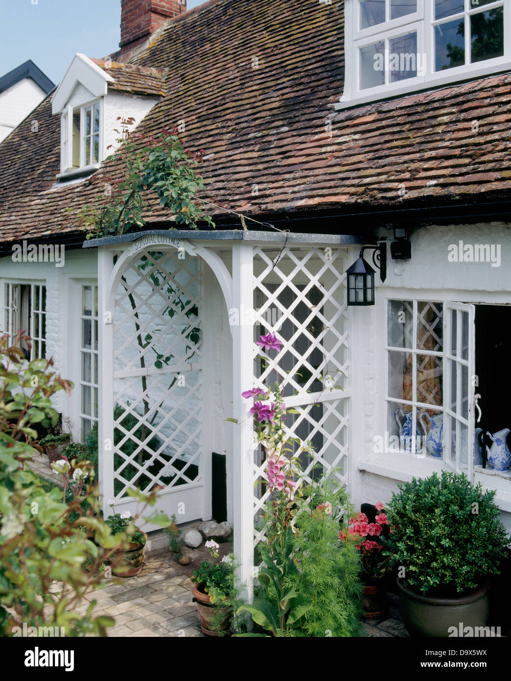 White 16th Century Cottage With Trellis Porch And Dormer