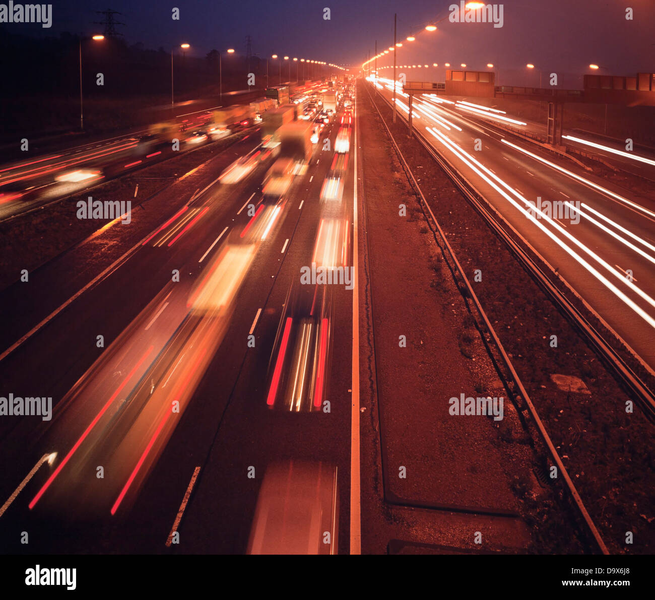 Motorway commuter traffic on the M1highway at night or late evening, UK - Stock Image