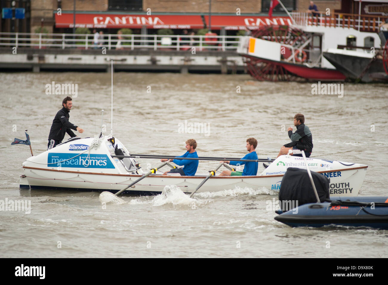 London, UK. 27th June 2013. The 4 man Islanders team shatter the round Britain GB Row and take first prize of £100,000.00 Stock Photo