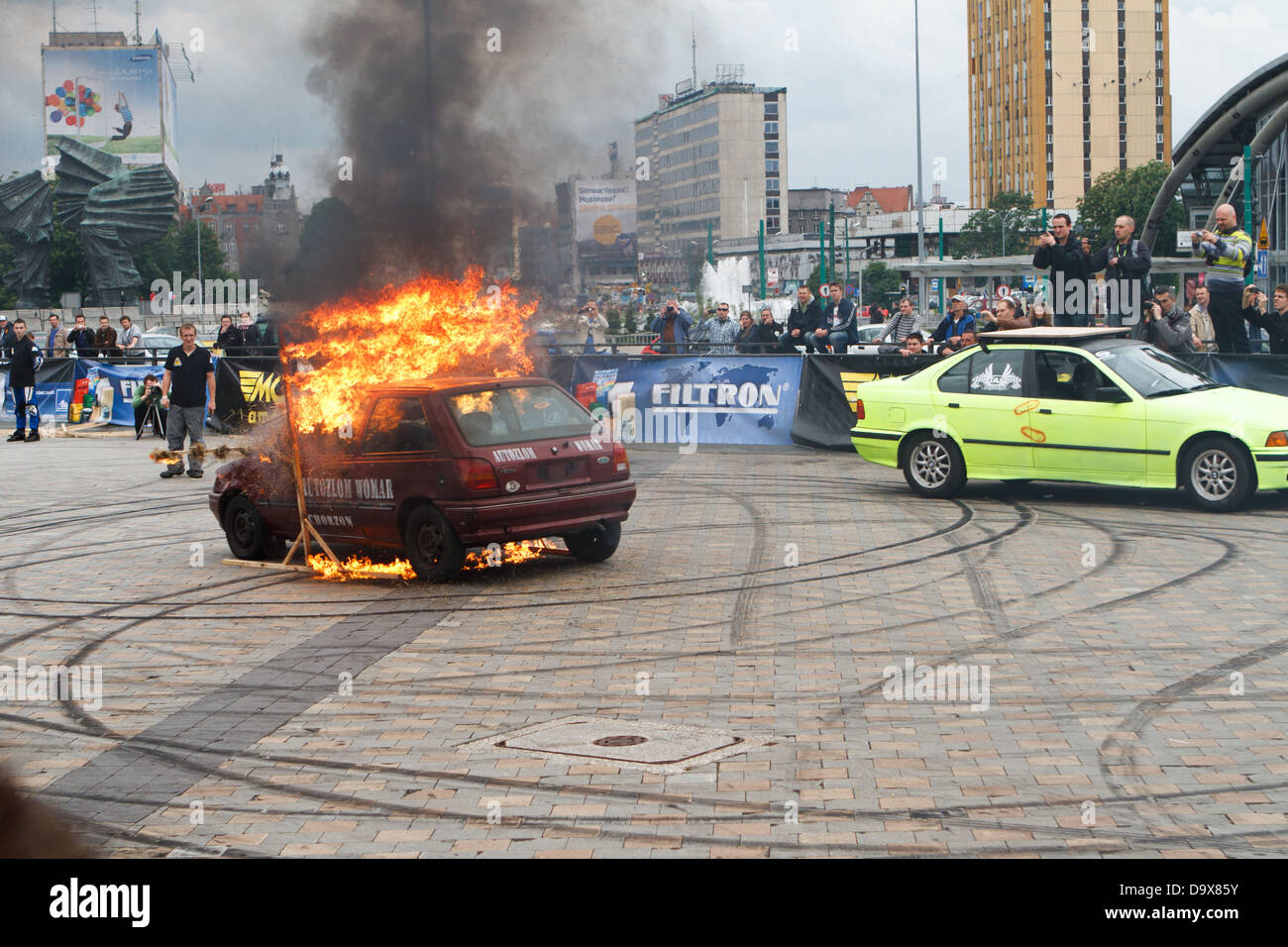 Car Stunt Show. Car driving through wall of fire. Katowice, Poland. - Stock Image