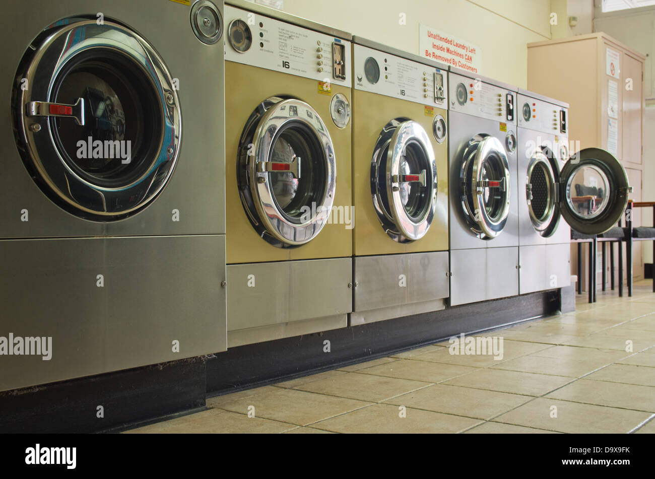 Stainless steel washing machines, coin operated - Stock Image