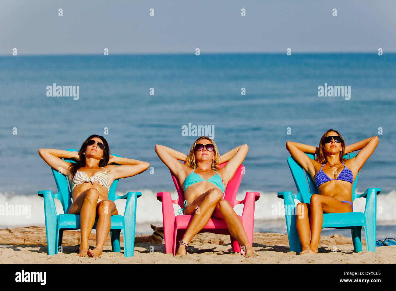 Tremendous Three Women Lounging On Beach Chairs Stock Photo 57743565 Ocoug Best Dining Table And Chair Ideas Images Ocougorg