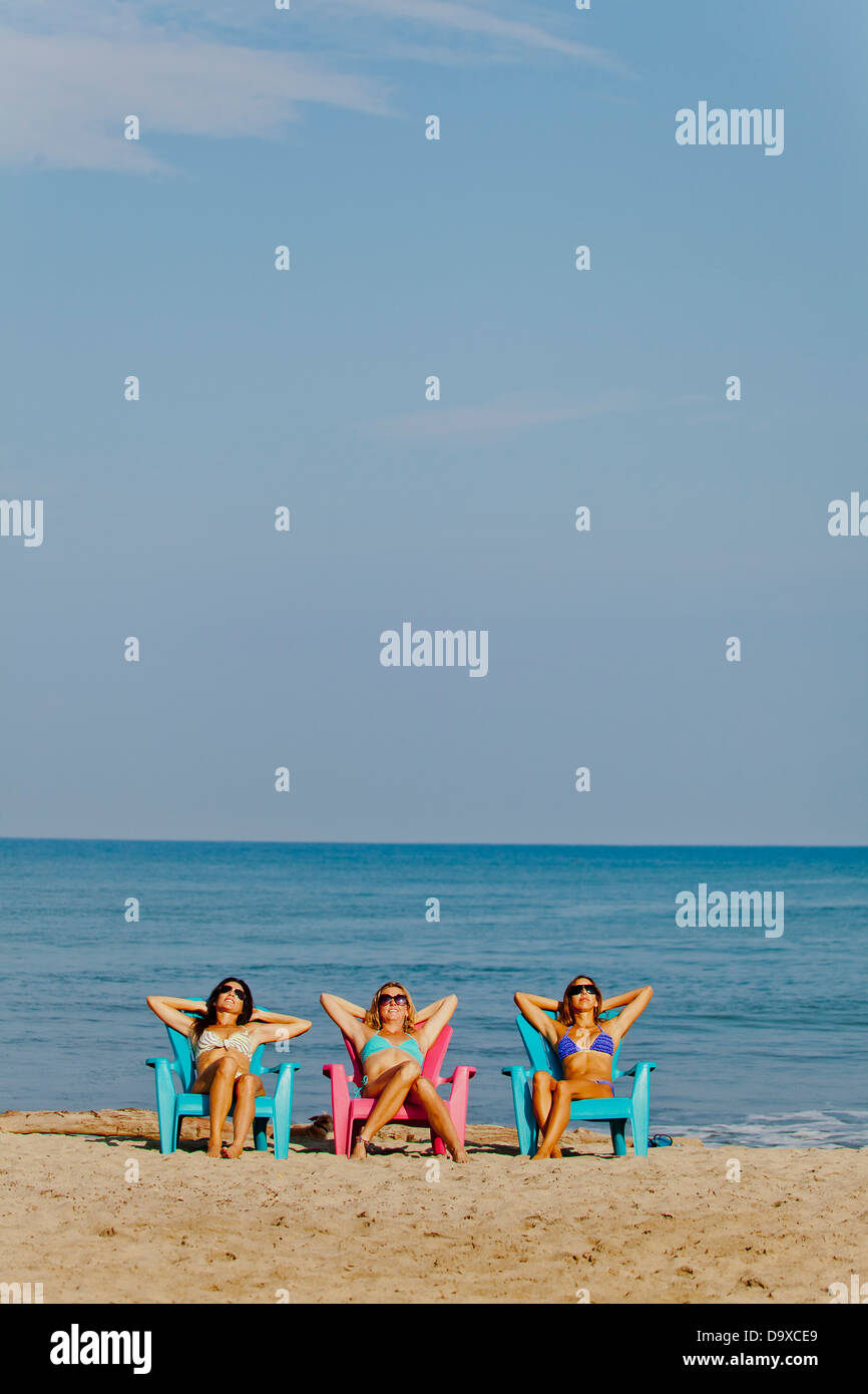 Awe Inspiring Three Women Lounging On Beach Chairs Stock Photo 57743569 Ocoug Best Dining Table And Chair Ideas Images Ocougorg