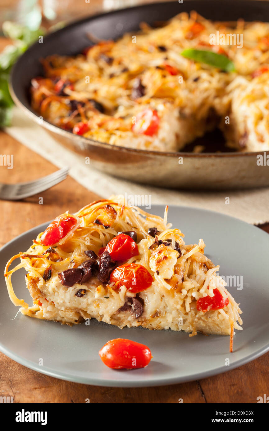 Homemade Baked Pasta Pie with Tomato and Basil - Stock Image