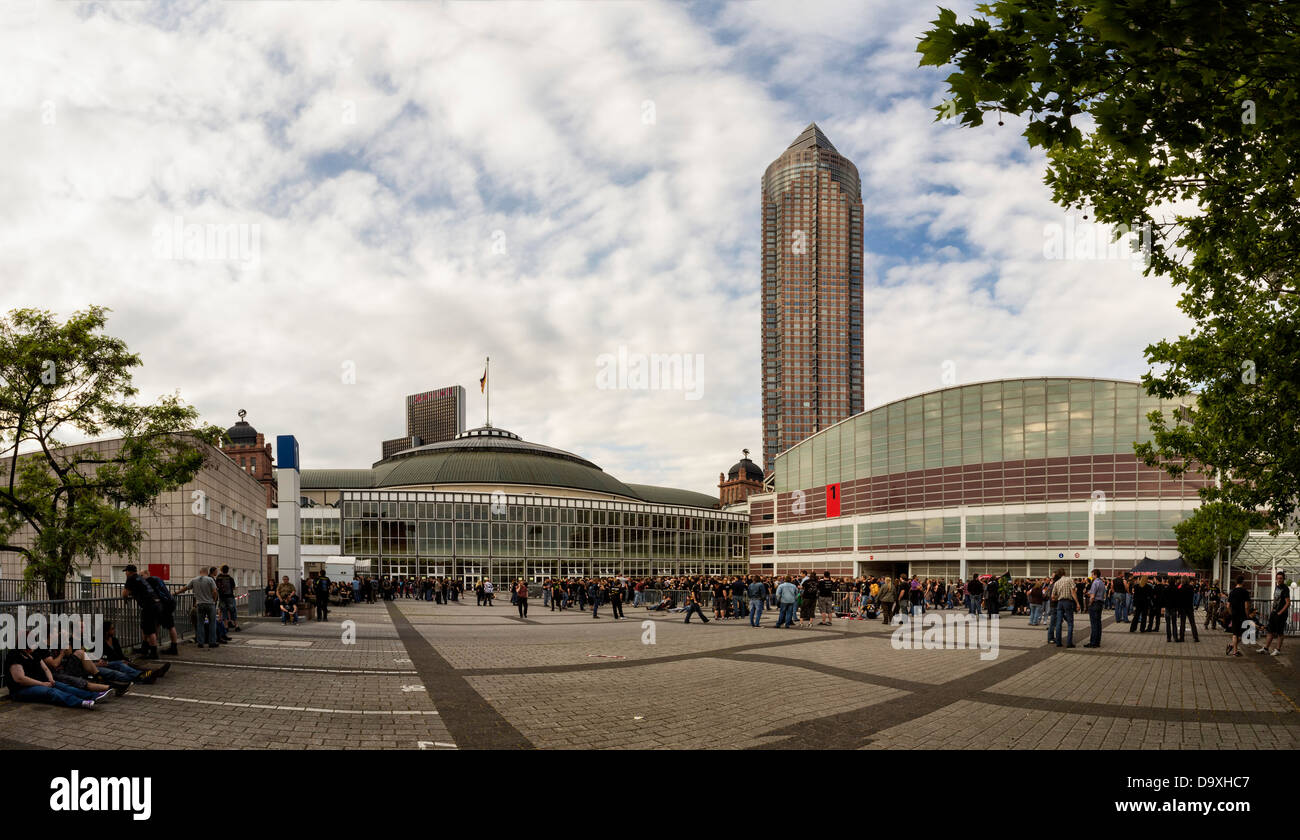 Germany, Frankfurt am Main, People waiting in line for entrance at the Festhalle Stock Photo
