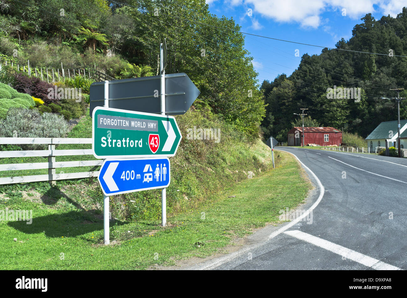 dh Forgotten World Highway WHANGAMOMONA NEW ZEALAND SH43 state highway road signpost sign nz north island - Stock Image