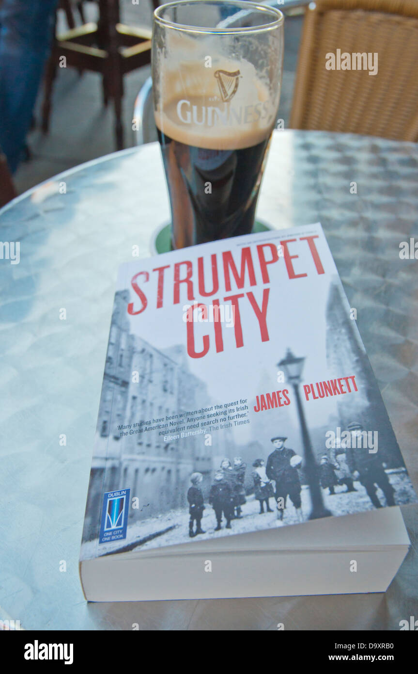 Irish epic social novel Strumpet City by James Blunkett and a pint of Guinness in Dublin Ireland Europe - Stock Image