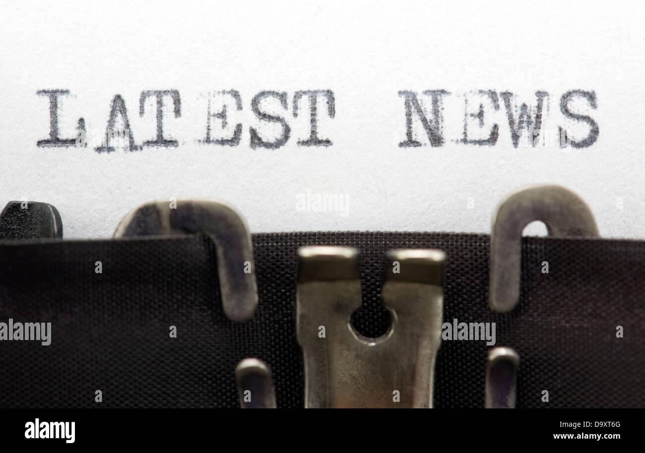 Latest news. Typewriter close-up shot. - Stock Image