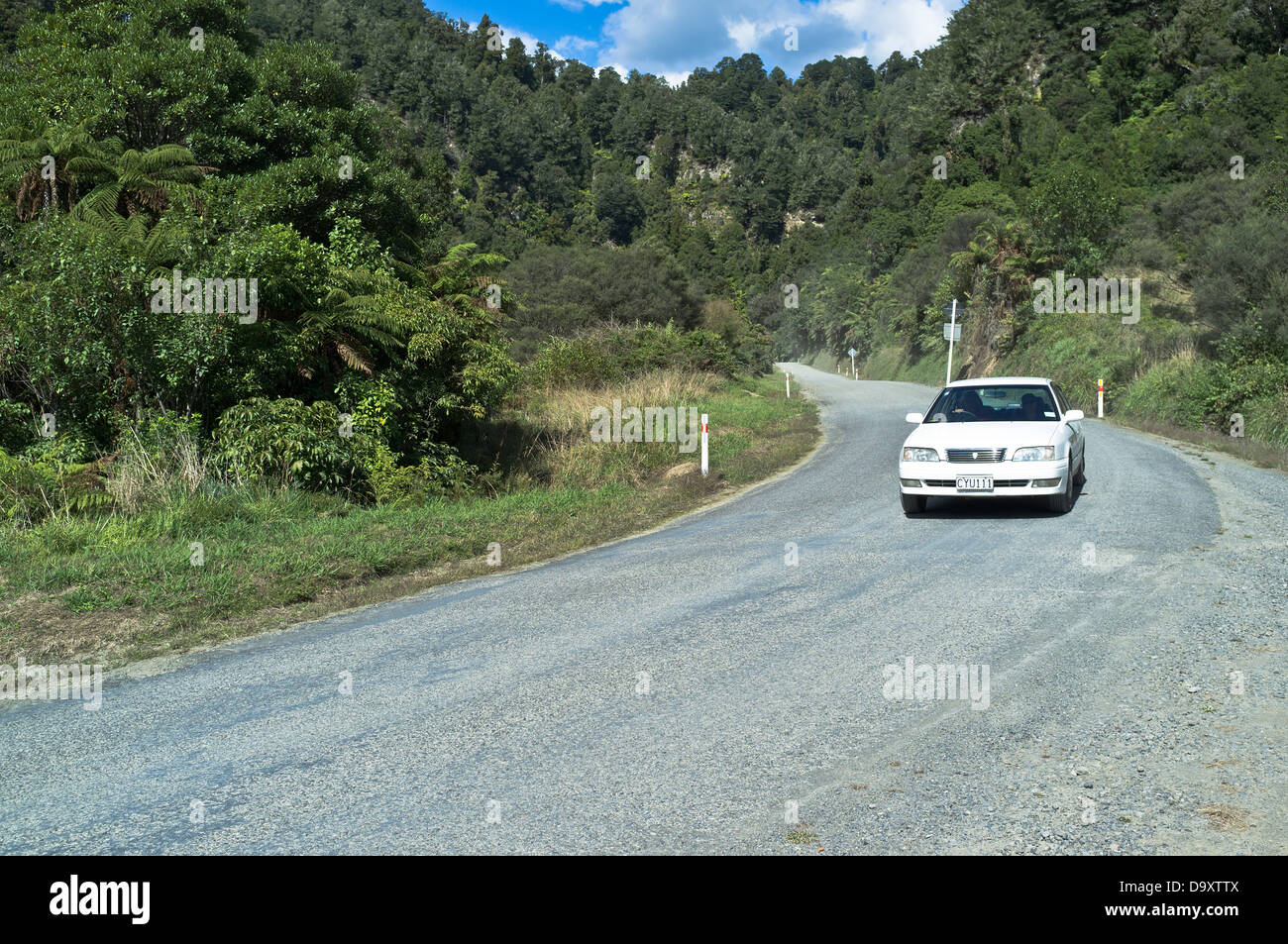 dh Forgotten World Highway OHURA ROAD NEW ZEALAND Motorcar on SH43 state highway road - Stock Image