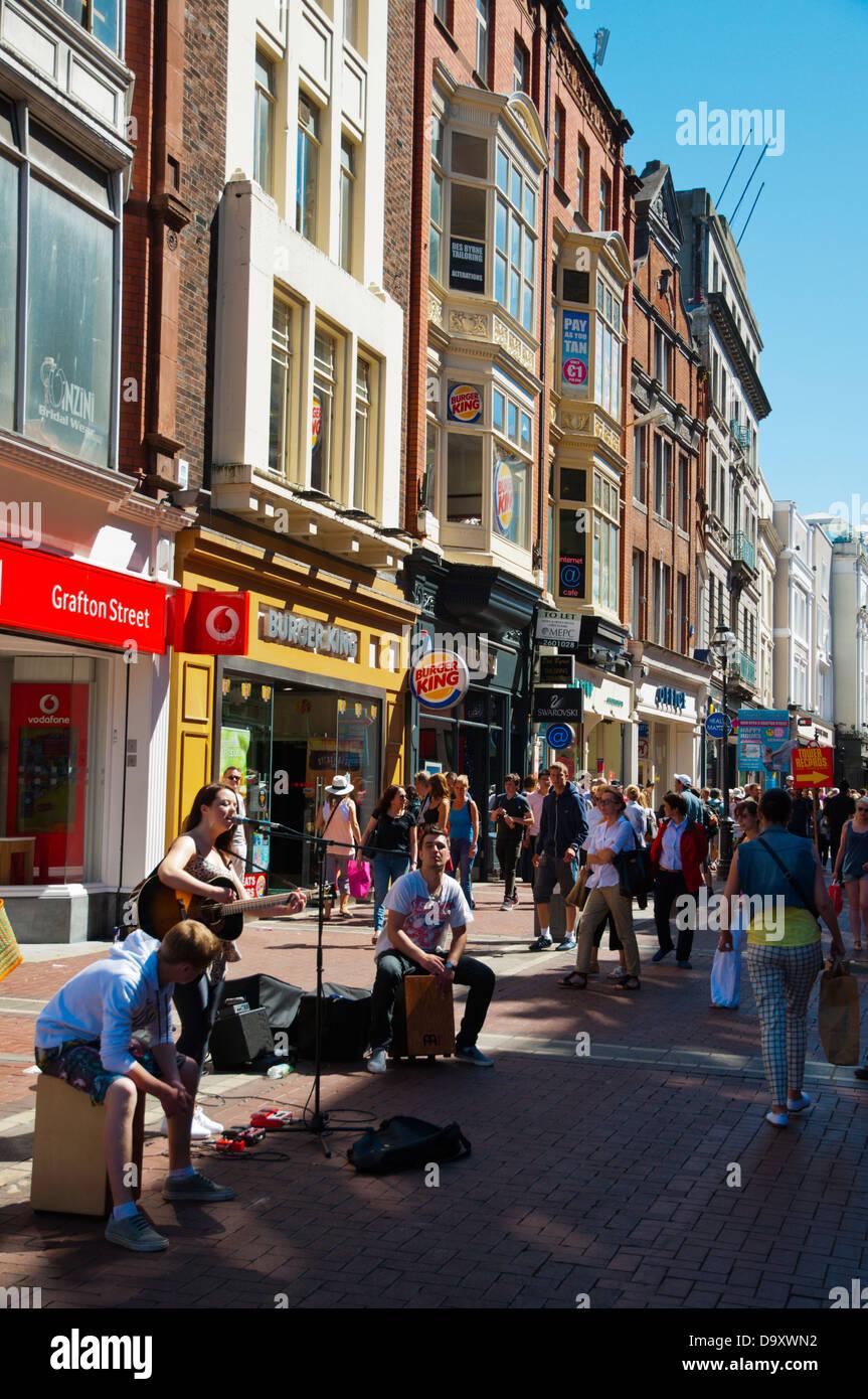 Busker band playing Grafton Street pedestrian street central Dublin Ireland Europe - Stock Image