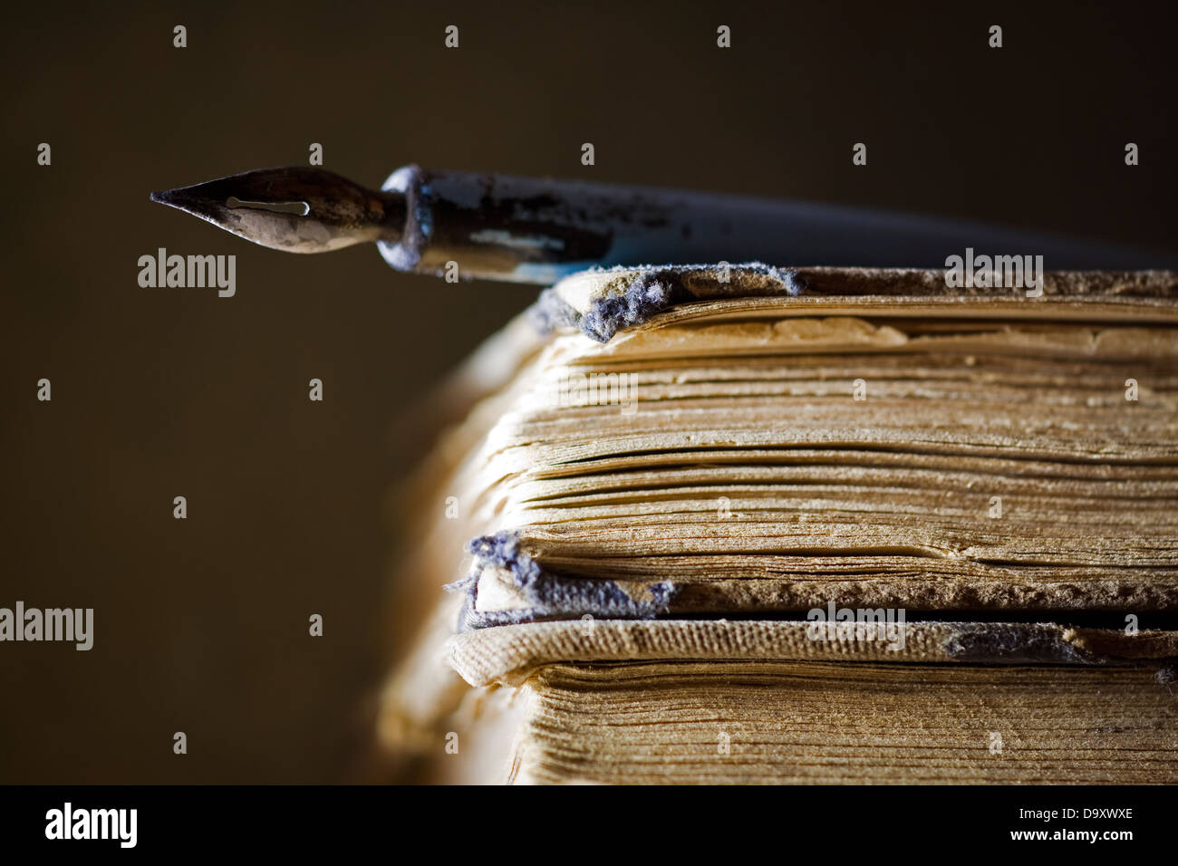 Old books and pen - Stock Image