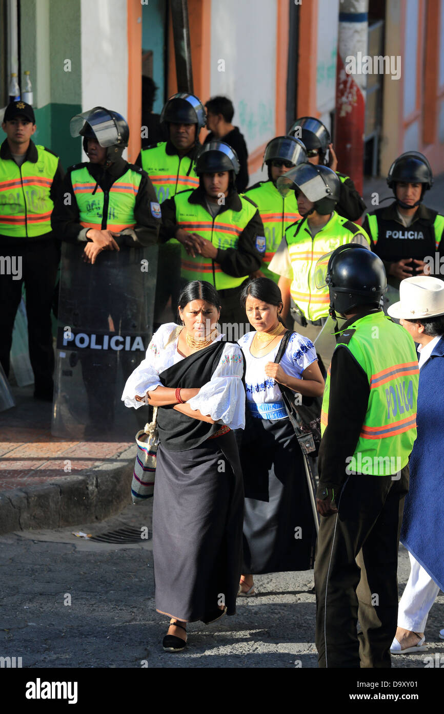 Riot police on high alert during indigenous Inti Raymi festivities in Cotacachi, Ecuador - Stock Image