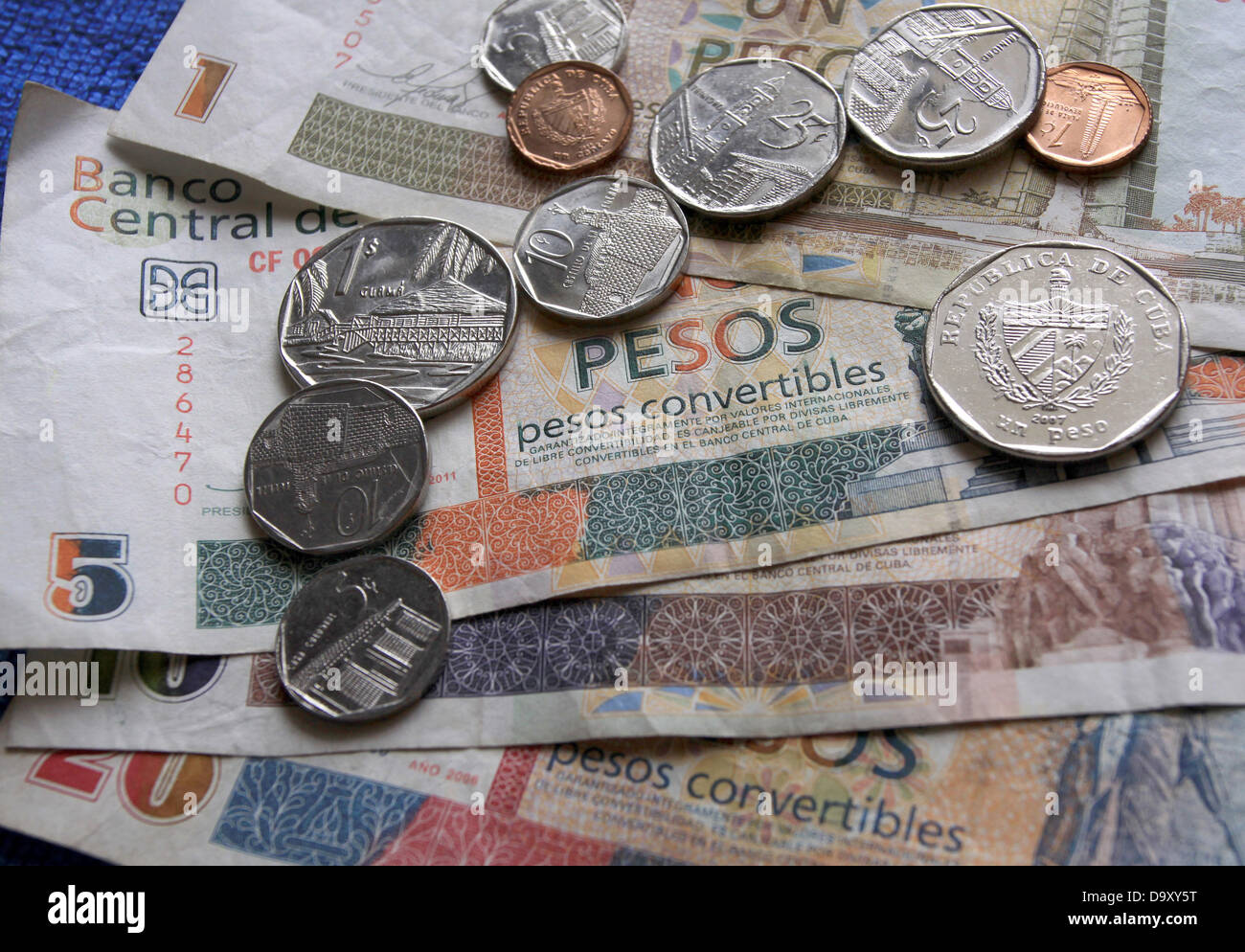 Different banknotes and coins of Cuban tourists currency Pesos Convertibles (CUC) whose value is linked to the US - Stock Image