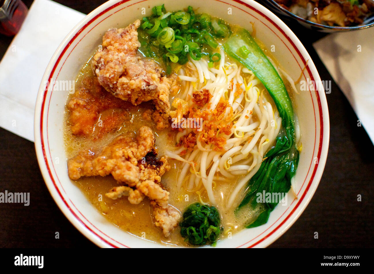 Large Bowl of Ramen Soup with Tempura in it. A typical Japanese Dish. - Stock Image