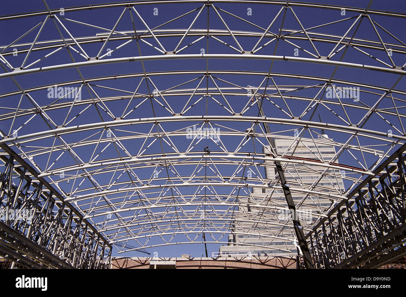 construction workers completing steel roof trusses stock image - Metal Roof Trusses