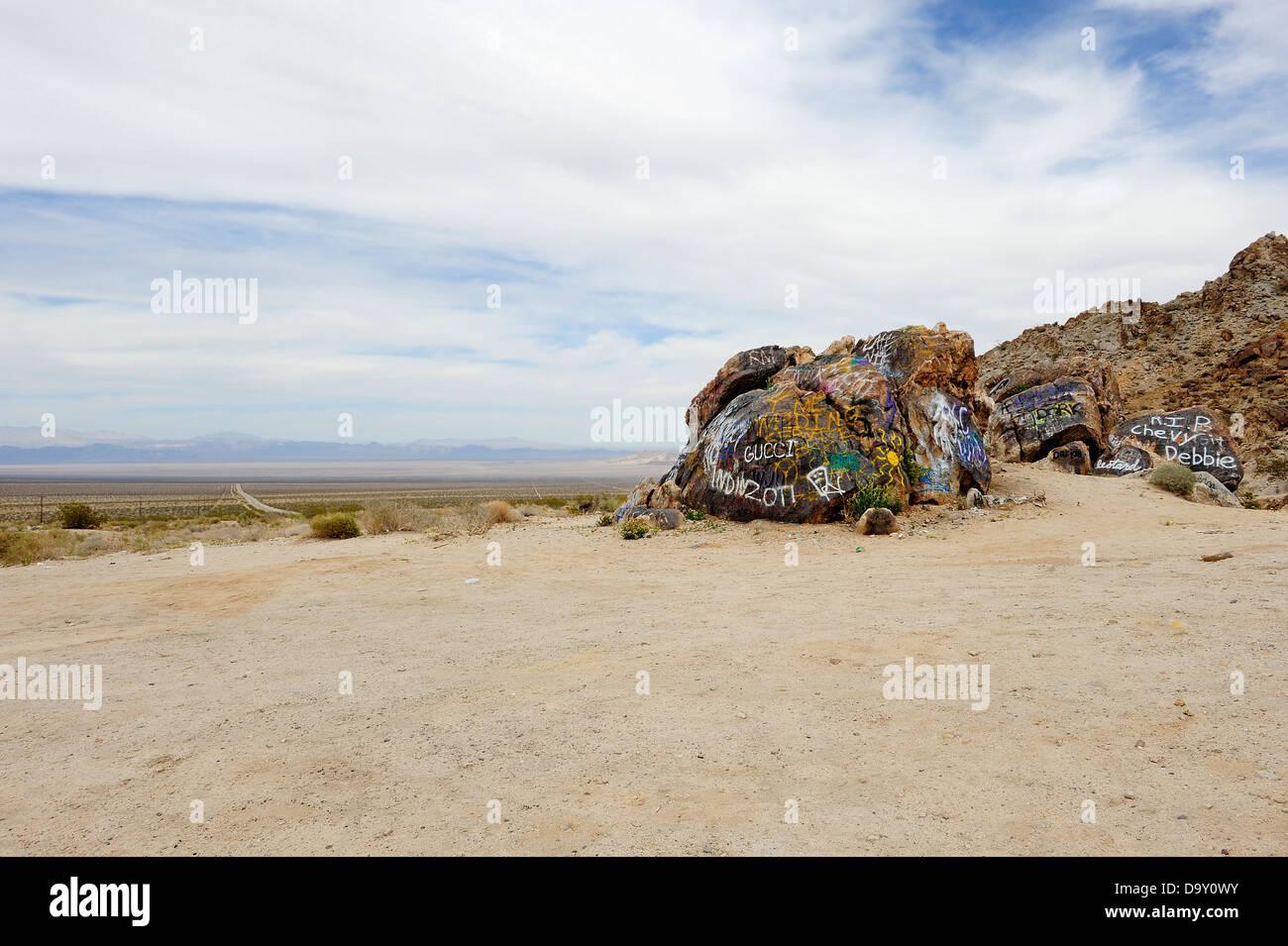 Mojave Desert landscape littered with rubbish and graffiti, California USA. - Stock Image