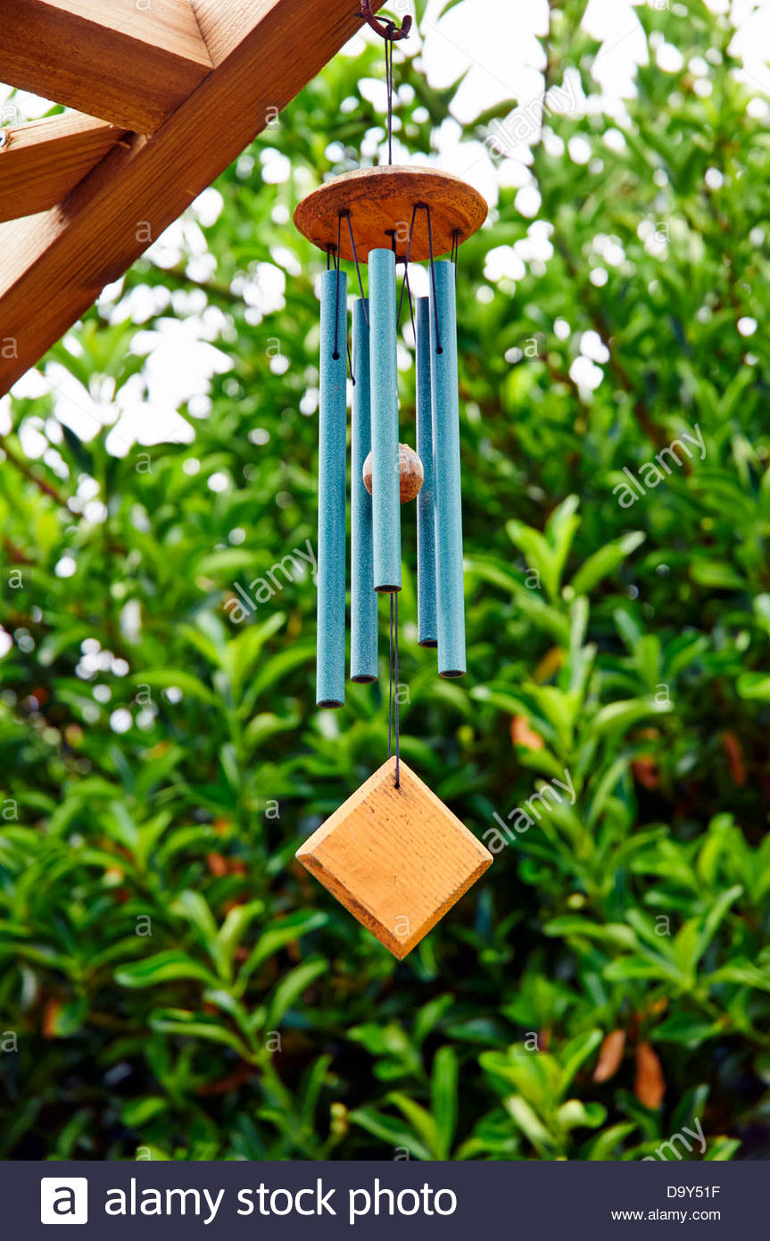 Decorative Wind Chimes With Green Metal Tubes On A Garden Ornament Hanging  From A Wooden Frame