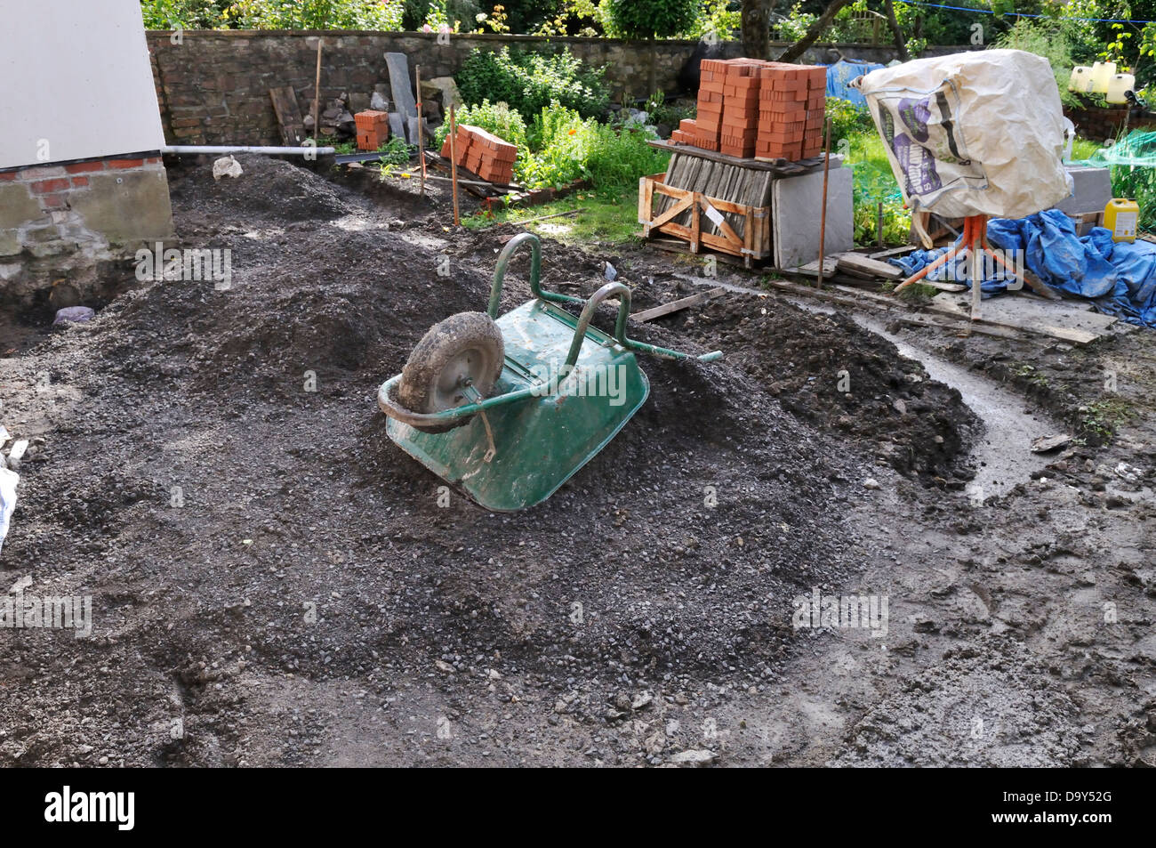 The mess that starts the building of a stone patio before laying paving - Stock Image