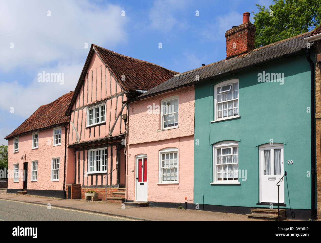 Row of colourful old cottages on Church Street in historic picturesque village of Lavenham, Suffolk, England, UK, - Stock Image