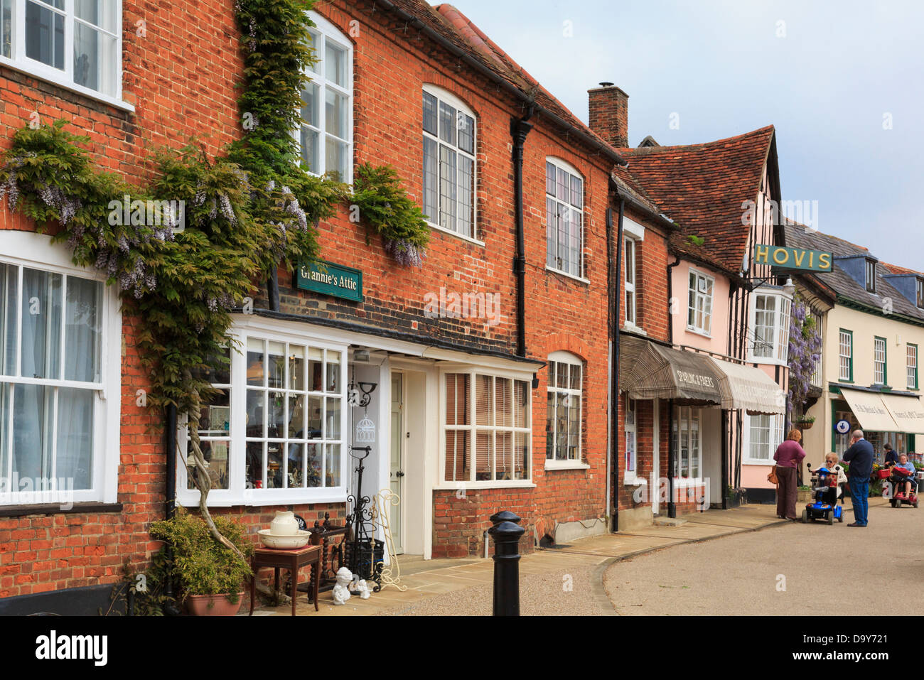 Old shops around Market Place in historic village of Lavenham, Suffolk, England, UK, Britain Stock Photo
