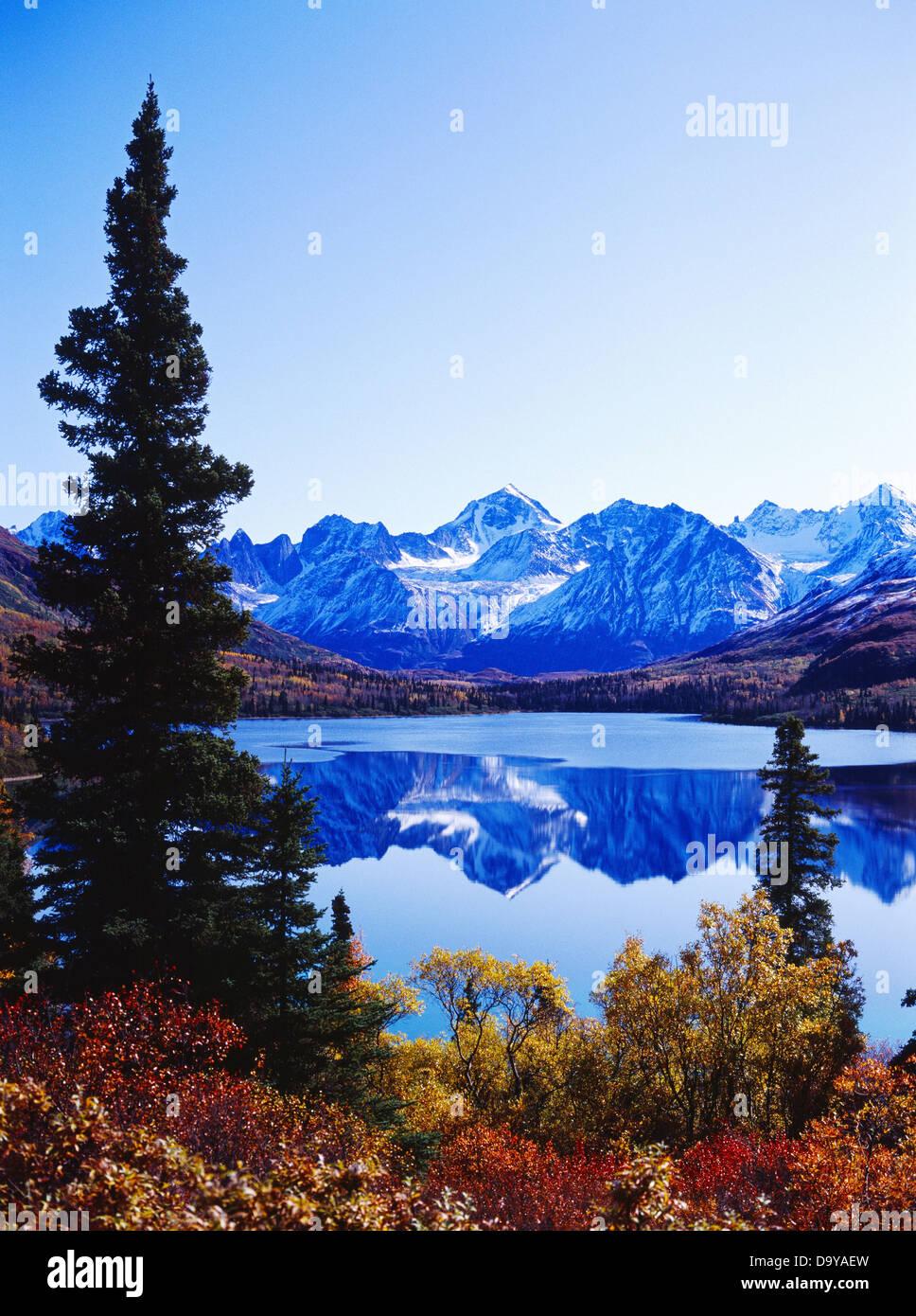USA, Alaska, Lake Clark National Park, Chigmit Mountains reflected in Portage Lake - Stock Image
