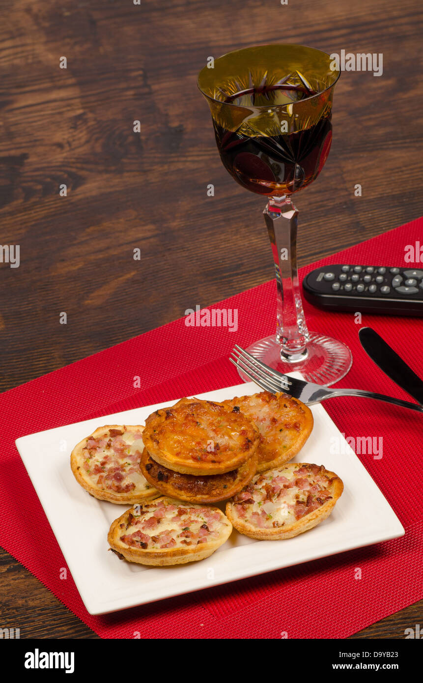 Pizza and television, a bachelor lifestyle concept - Stock Image