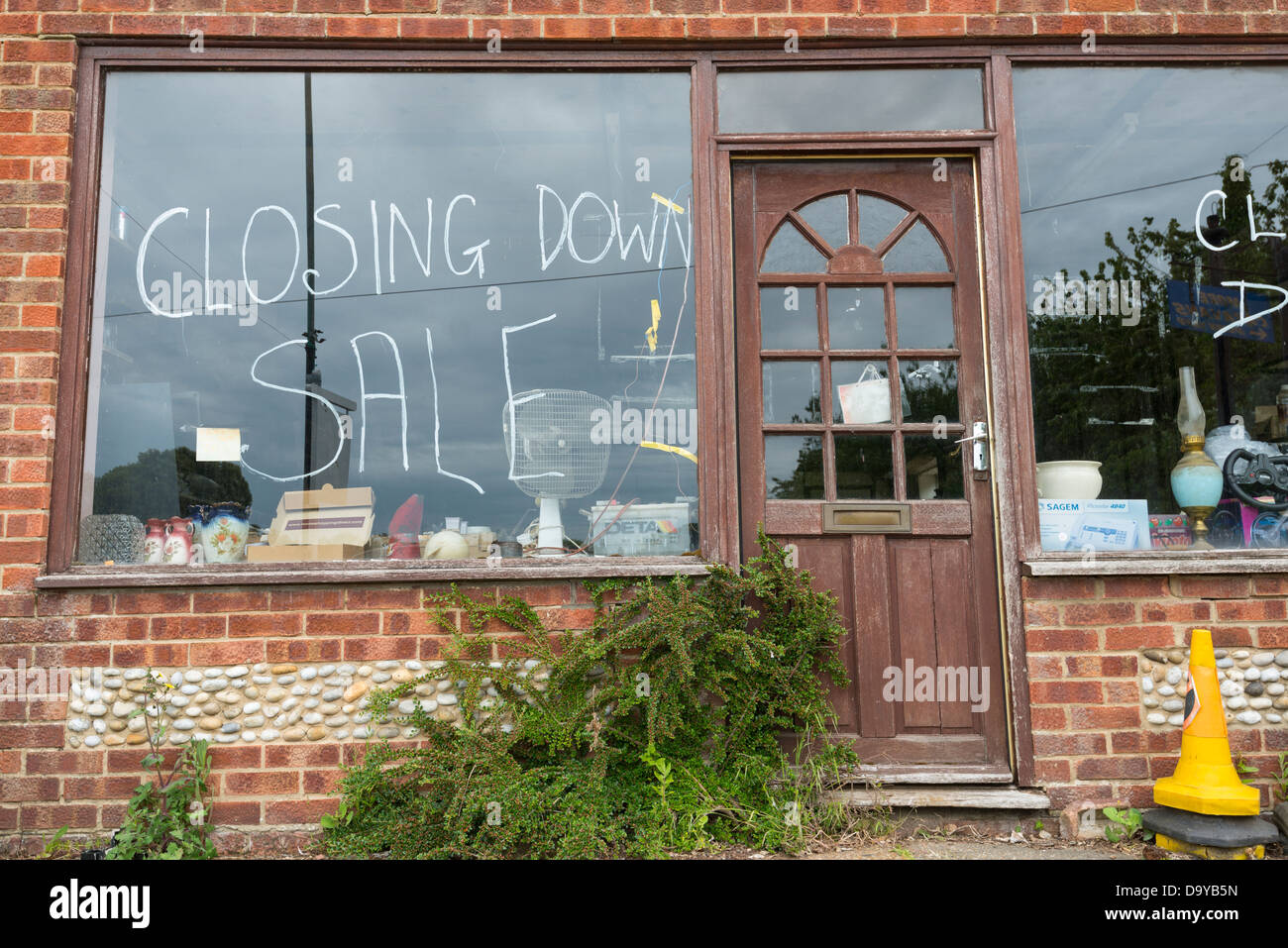 Shop front with 'closing down sale' painted on glass, Norfolk, England. - Stock Image