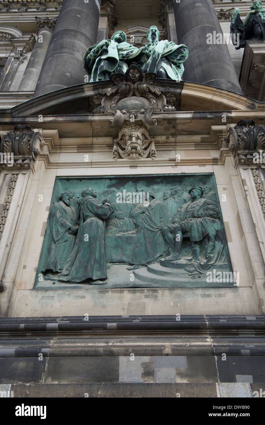 detail of the berliner dom with plaque showing martin luther before
