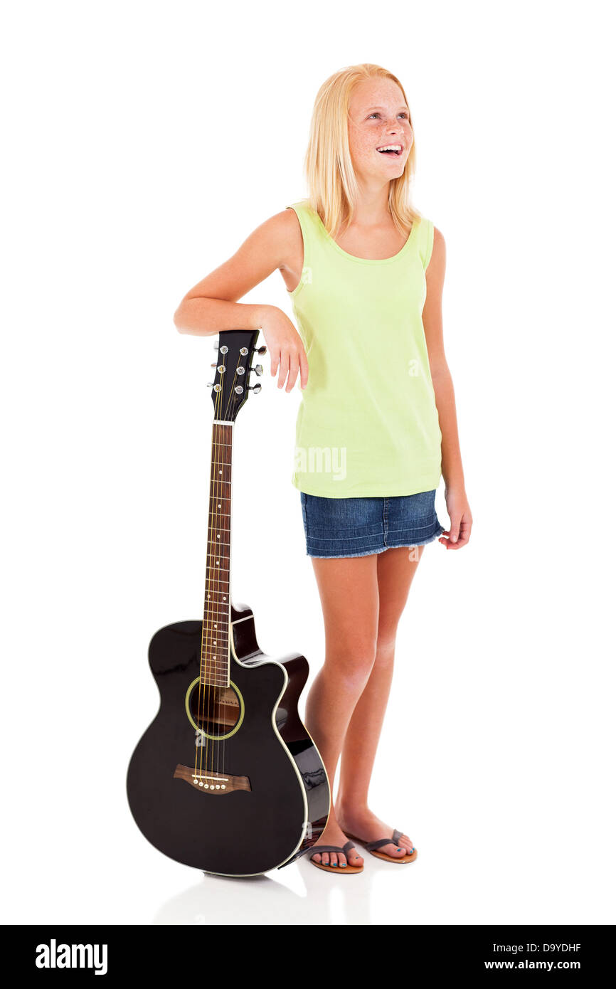 beautiful young pre teen girl posing with a guitar on white background - Stock Image