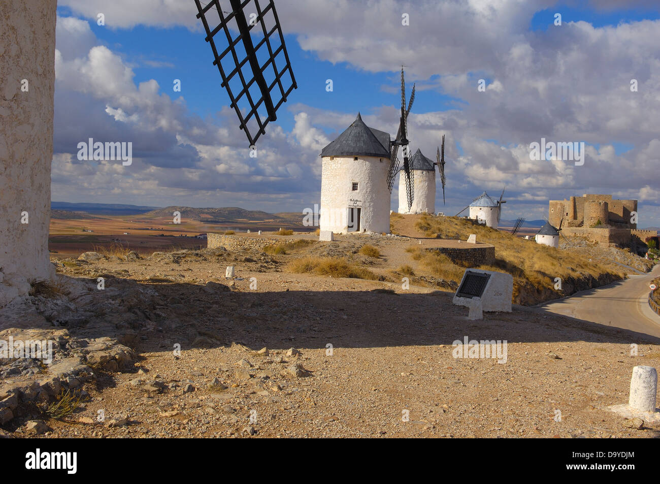 Windmills and Castle of the Knights of St. John of Jerusalem, Consuegra, Toledo province, Route of Don Quixote, - Stock Image