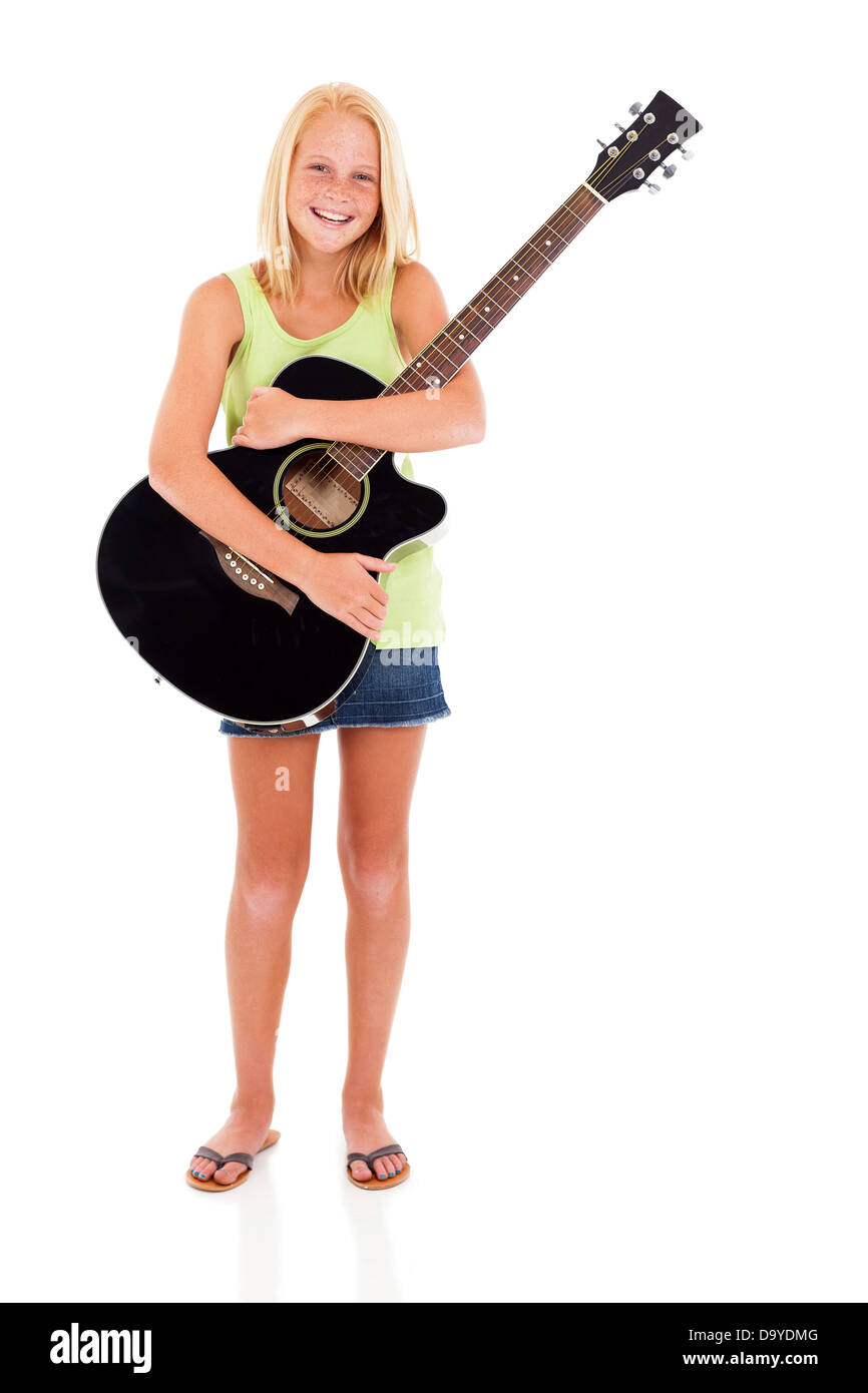 cheerful teen girl holding a guitar on white background - Stock Image
