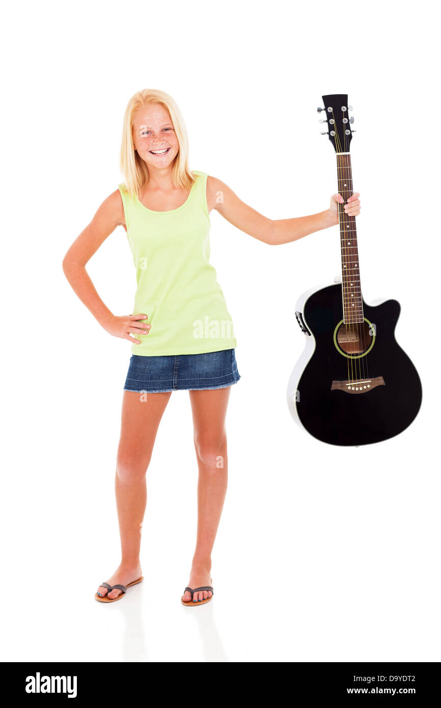 cheerful pre teen girl showing her guitar on white background - Stock Image