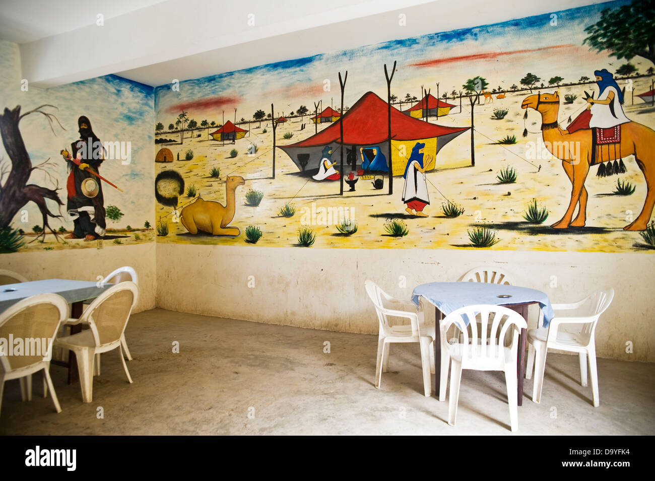 Mural of camels and Touareg tents on wall of café, Timbuktu, Mali ...
