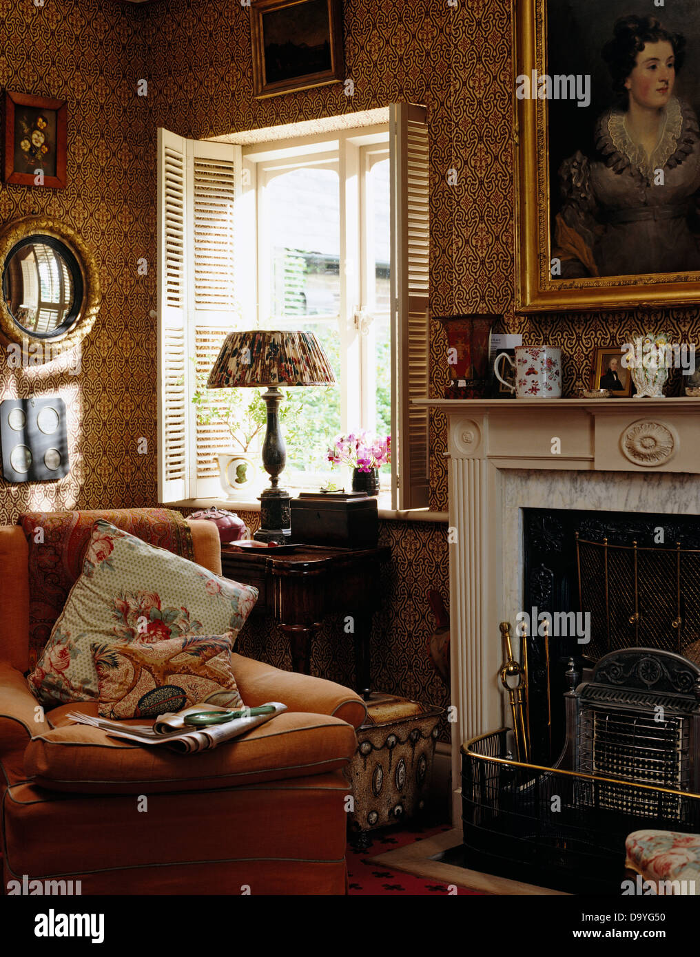 Comfy armchair beside fireplace in victorian style living - Victorian style living room ...