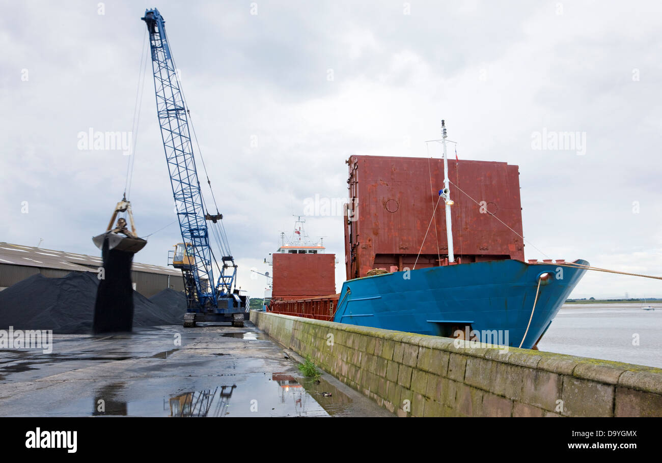Container ships unloading coal by crane at Glasson Dock, Lancashire, England Stock Photo