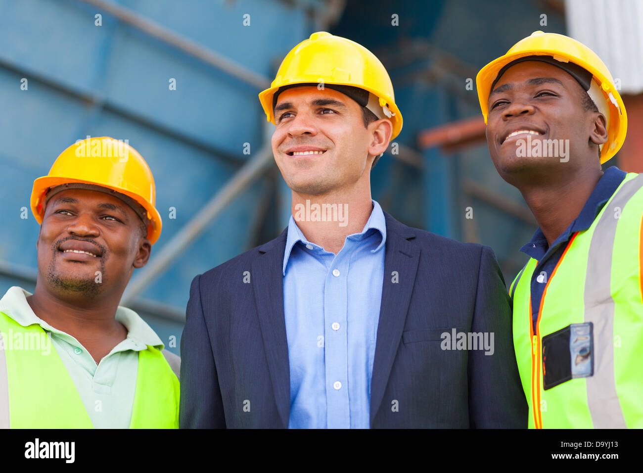 optimistic heavy industry manager and workers portrait - Stock Image