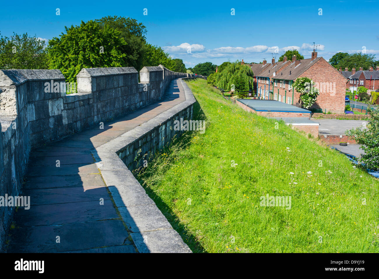 The City Wall with local authority housing, York, England, June - Stock Image