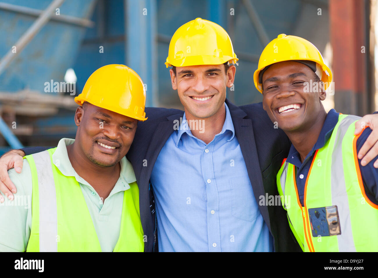 happy heavy industry manager and workers portrait - Stock Image