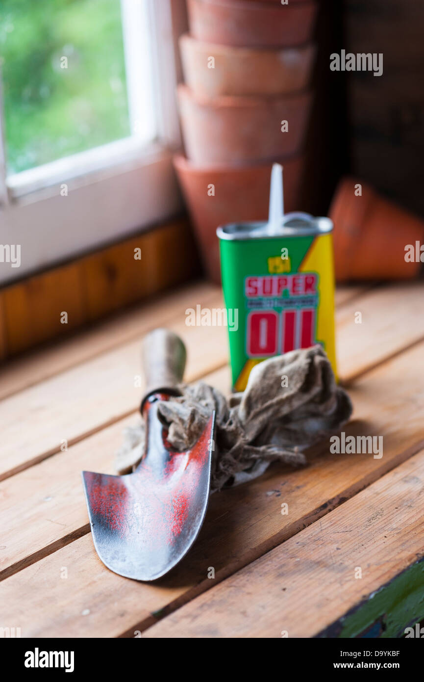 d23b46e826ff54 Garden hand trowel with cleaning rag and oil. - Stock Image