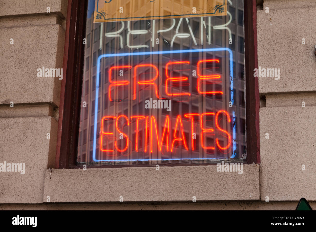Free estimates neon sign - Stock Image