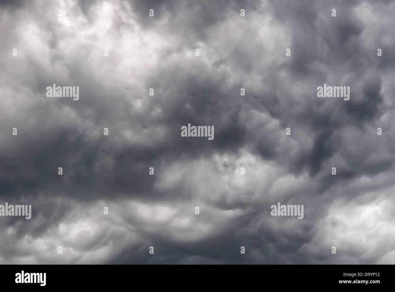 Background of storm clouds before a thunder-storm - Stock Image