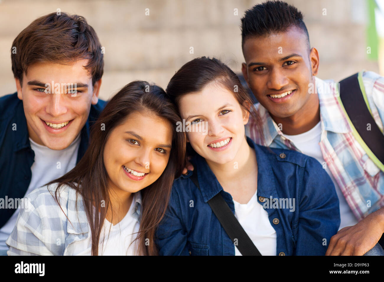 group of happy teen high school students outdoors - Stock Image