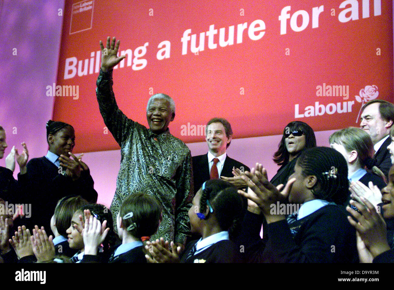 South African President Nelson Mandela waves to the audience at the Labour Party Conference in The Brighton Centre - Stock Image