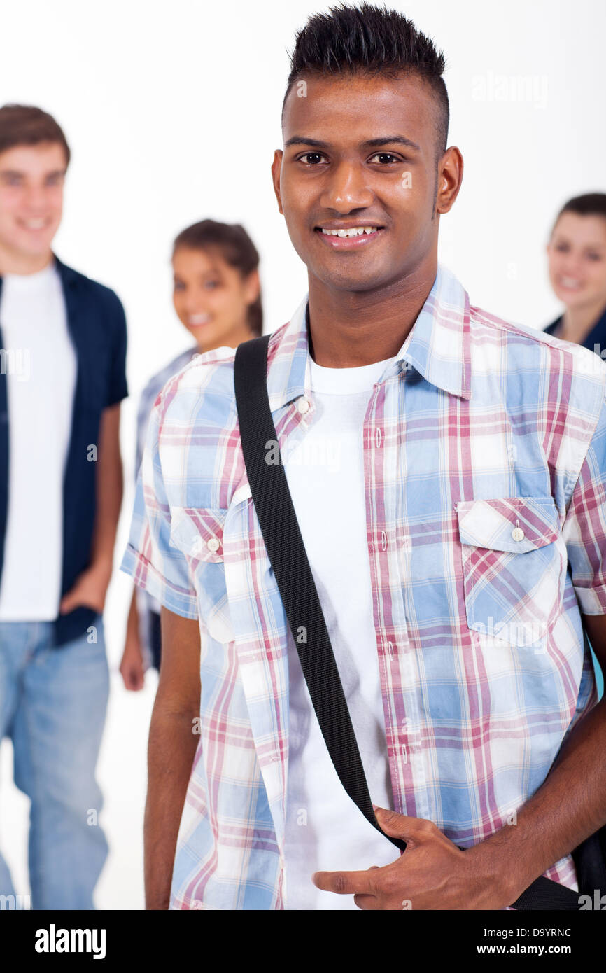 handsome Indian high school student with schoolmates on background - Stock Image