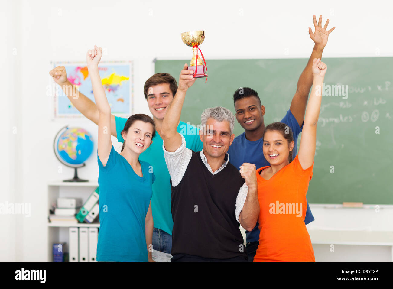 happy high school class wining a trophy - Stock Image