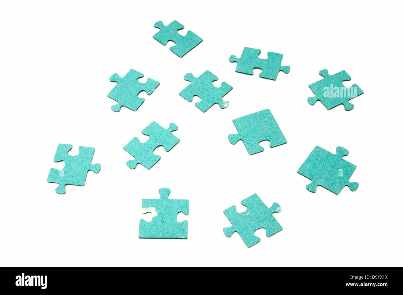 jigsaw pieces on a white background - Stock Image