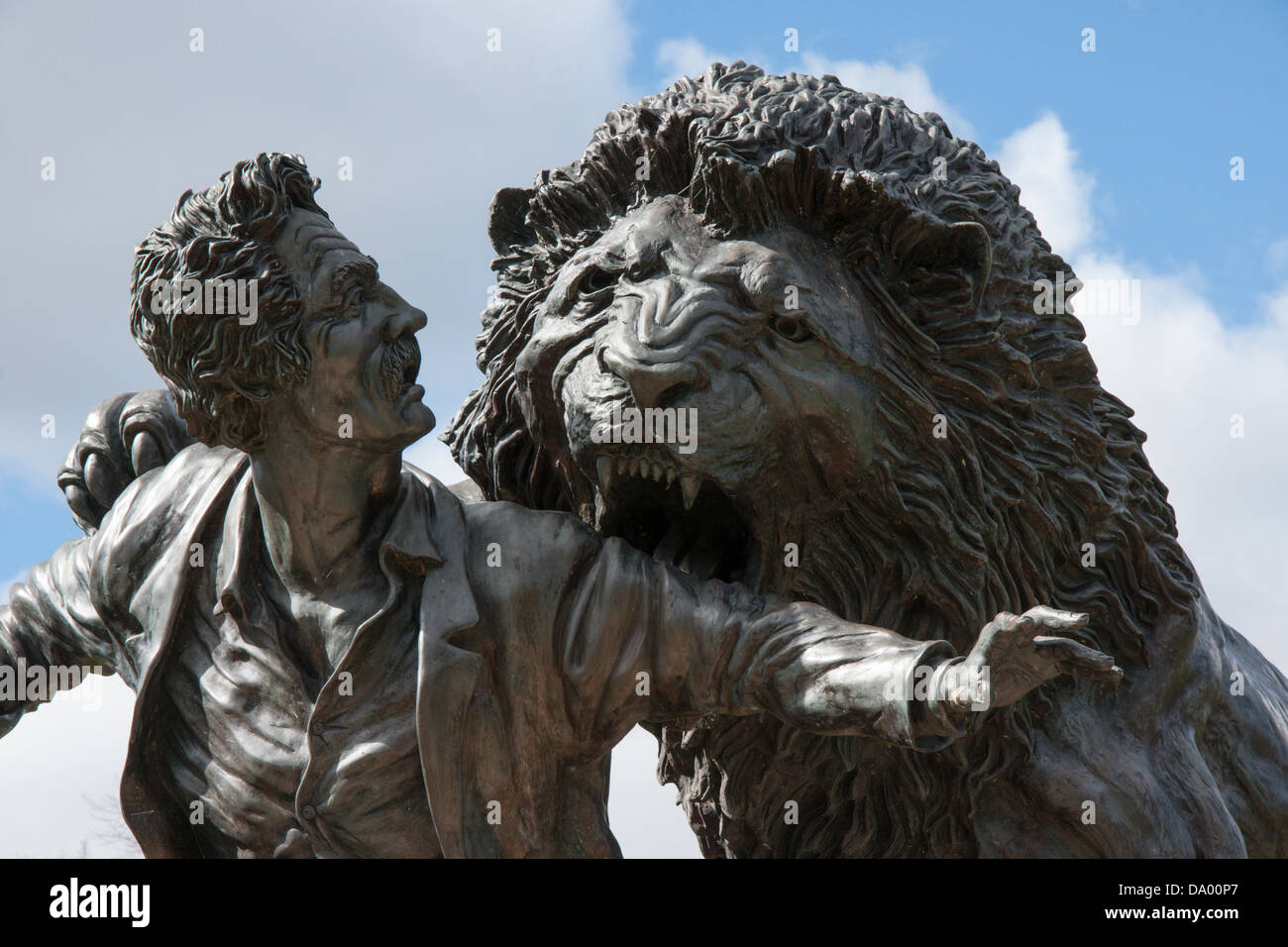 Detail from the statue at the David Livingstone Centre, Blantyre, Scotland of the explorer being attacked by a lion - Stock Image