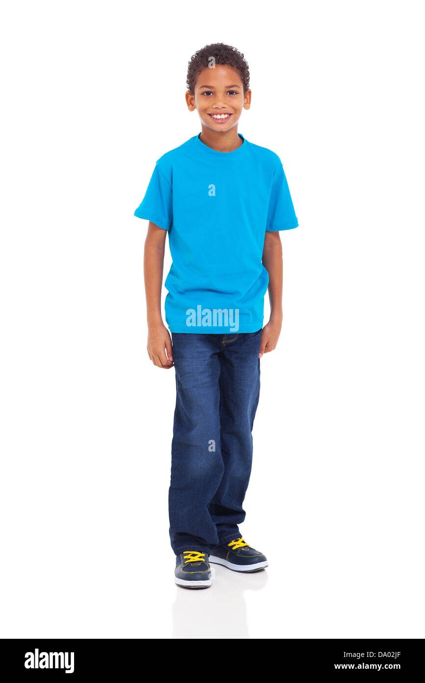 happy young indian boy standing on white background - Stock Image